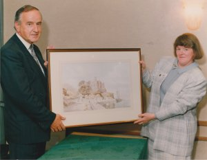Taoiseach Albert Reynolds presented with a watercolour by hamilton sloan of King Johns castle Carlingford by the carlingford heritage centre county louth