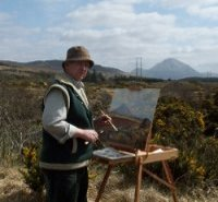 Hamilton Sloan traditional irish artist at his easel outside painting mount Errigal