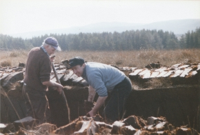 two members of the Boyle family cutting turf