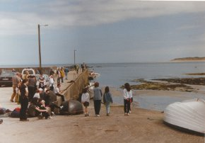 people waiting at the pier for the boat to tory island